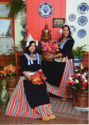 My sister and I in traditional Dutch get-ups - Edam, Netherlands
